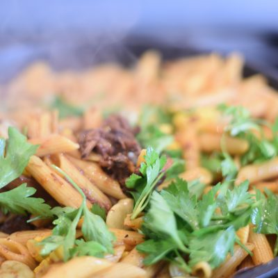 Pasta with oxtail and fava beans